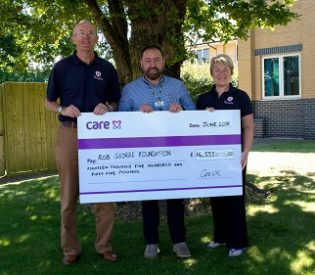 Lion-hearted Care UK adventurer hands over cheque to Colchester based Rob George Foundation