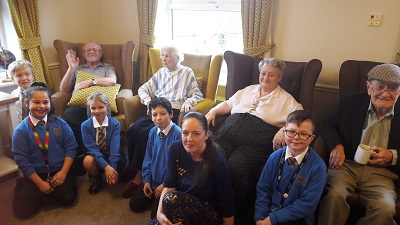 Intergenerational social club connects former teacher with local school children